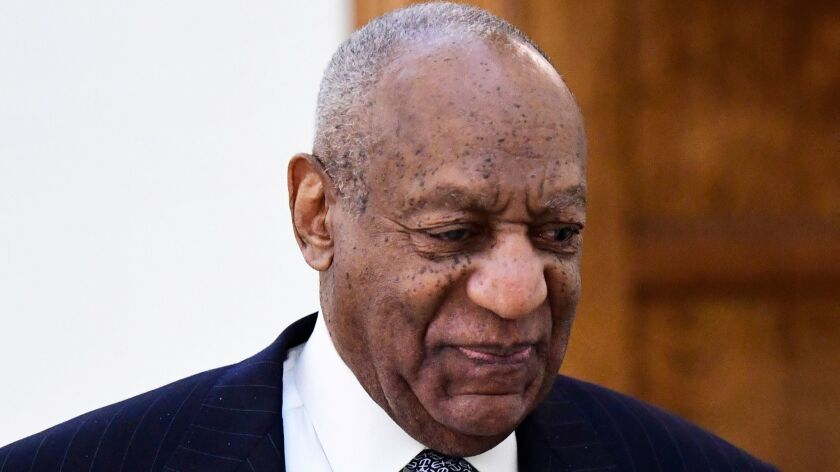 Entertainer Bill Cosby walks back to a courtroom April 4 after a break in his sexual assault trial at the Montgomery County Courthouse in Norristown, Pa.