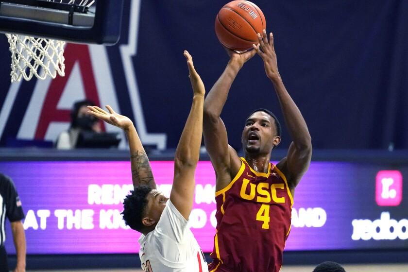 USC forward Evan Mobley shoots over Arizona forward Ira Lee