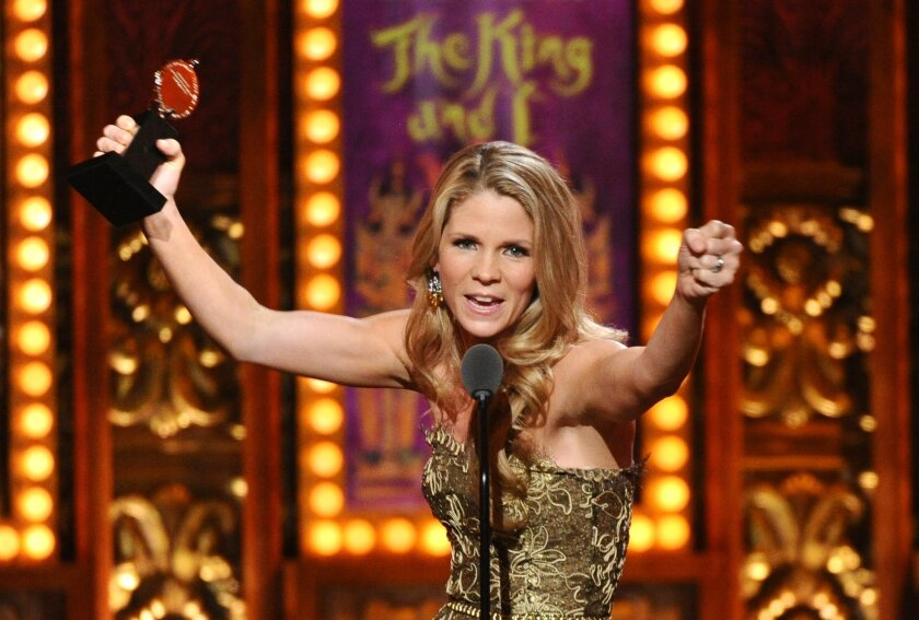 """FILE - In this June 7, 2015, file photo, Kelli O'Hara accepts the award for best performance by an actress in a leading role in a musical for """"The King and I"""" at the 69th annual Tony Awards at Radio City Music Hall in New York. O'Hara will play her final performance as Anna Leonowens on April 17, 2"""