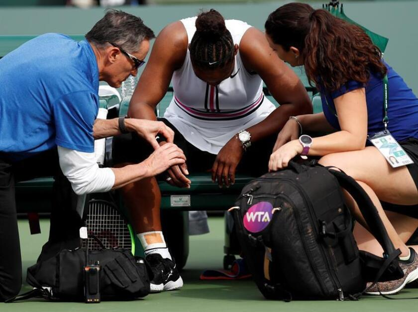 Serena Williams of the US gets her pulse checked by a trainer before retiring her match against Garbine Muguruza of Spain during the BNP Paribas Open tennis tournament at the Indian Wells Tennis Garden in Indian Wells, California, USA, 10 March 2019. The men's and women's final will be played, 17 March 2019. EPA-EFE/JOHN G. MABANGLO
