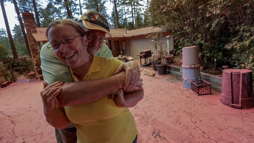 Steve and Suzanne Coffer have lived in their current Idyllwild home for 24 years. On Thursday morning, they found it covered in retardant, but safe.