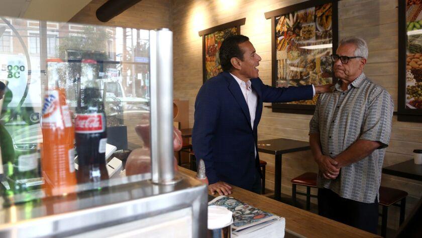 Antonio Villaraigosa talks with Milpa Grille owner Dan Morales on Saturday.