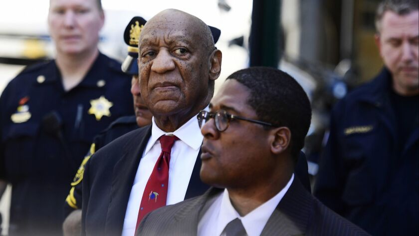 Bill Cosby looks around before he leaves the Montgomery County Courthouse on Thursday in Norristown, Pa.