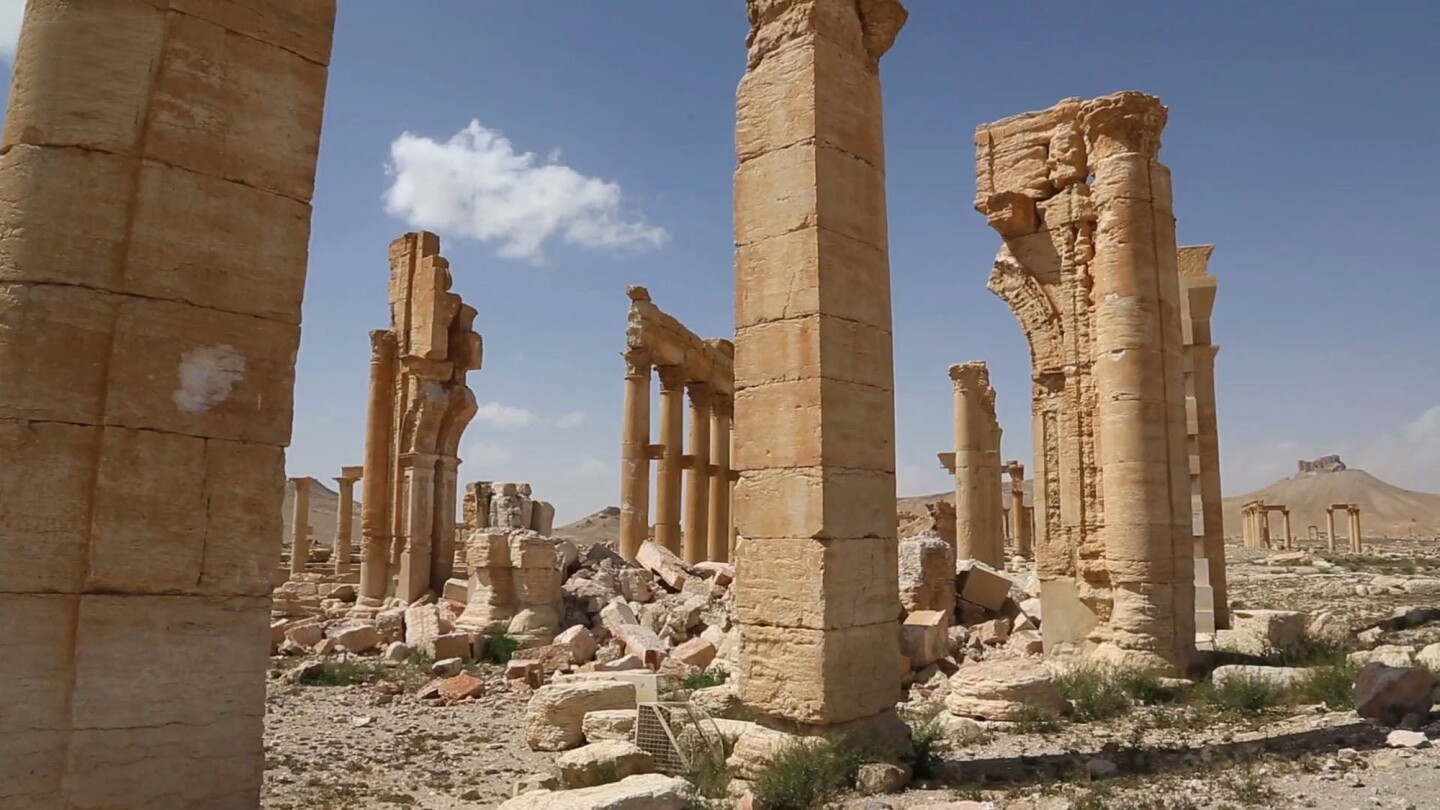This photo released March 28 shows some damage at the ancient ruins of Palmyra, central Syria. A Syrian antiquities official says de-mining experts have removed 150 bombs planted by the Islamic State group inside the archaeological site.