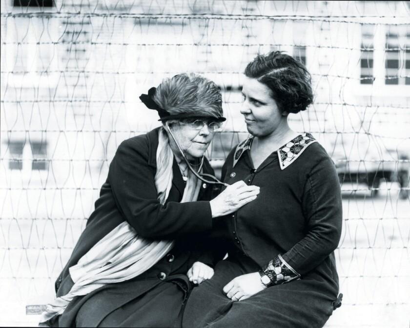 Dr. Charlotte Baker uses a stethoscope on Mrs. R.M. Moran on Dec. 18, 1925.