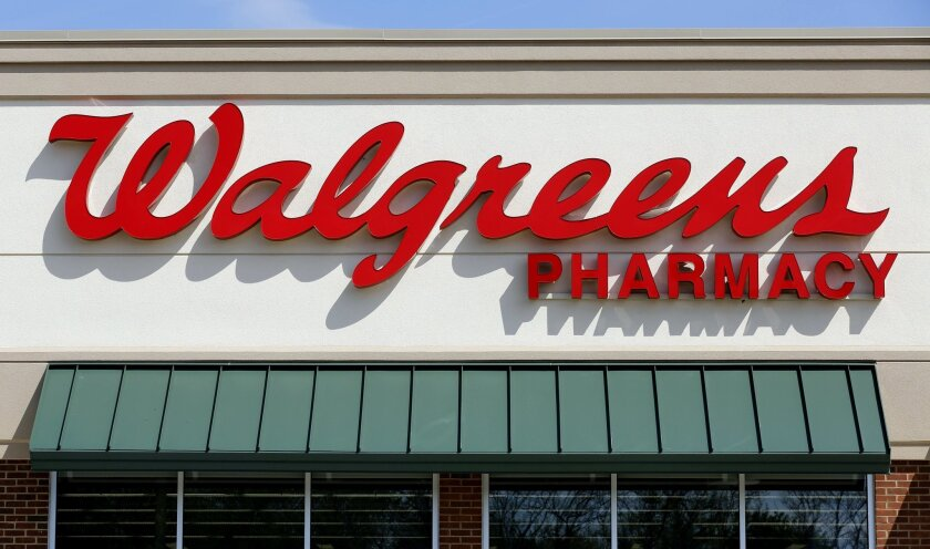 This Wednesday, May 14, 2014 photo shows a Walgreens store in Boston. Walgreen Co. on Monday, Sept. 8, 2014 said it is naming Jana Partners founder Barry Rosenstein to its board of directors and will give the activist hedge fund a say in naming at least one more director for the drugstore chain's board. (AP Photo/Steven Senne)