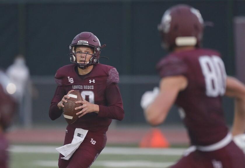Laguna Beach quarterback Will Bingham sets up to pass to Ryner Swanson  against Costa Mesa.
