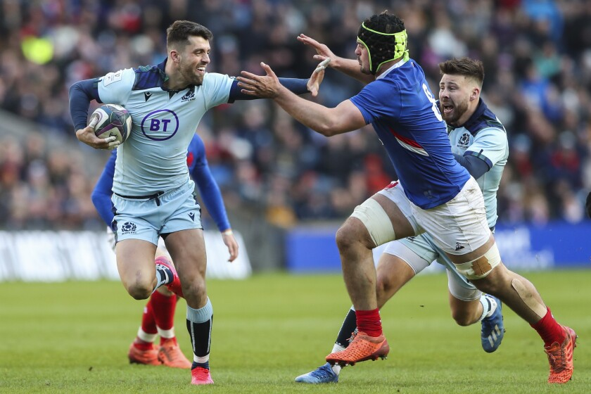 Scotland's Adam Hastings, left, runs with the ball next to France's Gregory Alldritt during the Six Nations rugby union international match between Scotland and France at the Murrayfield stadium in Edinburgh, Scotland, Sunday, March 8, 2020. (AP Photo/Scott Heppell)
