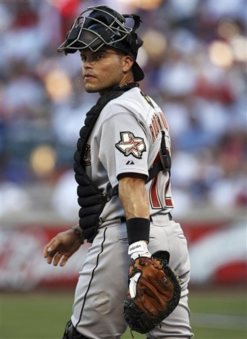 """Houston Astros catcher Ivan """"Pudge"""" Rodriguez walks to the mound in the bottom of the first inning of a baseball game against the Texas Rangers in Arlington, Texas, Tuesday, June 16, 2009. Rodriguez caught in his 2,226th career game to tie Carlton Fisk's major league record for games played as a catcher. (AP Photo/Tom Pennington)"""
