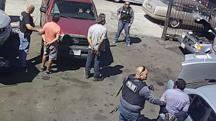 A video provided by the ACLU shows Juan Hernandez Cuevas, 46, lower right, being arrested in an ICE