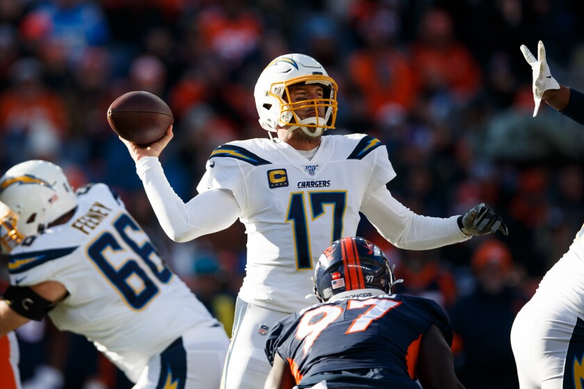 Chargers quarterback Philip Rivers throws a pass while under pressure from Denver Broncos linebacker Jeremiah Attaochu (97) during the first quarter on Sunday in Denver.