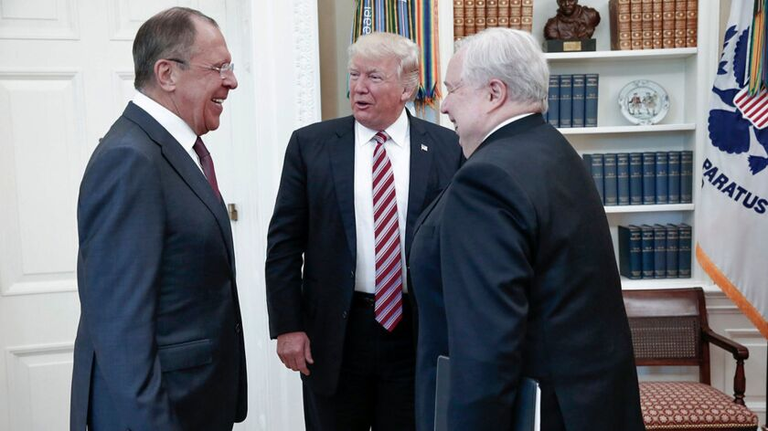 U.S. President Donald Trump meets with Russian Foreign Minister Sergey Lavrov, left, and Russian Ambassador to the U.S. Sergei Kislyak at the White House in Washington on May 10.