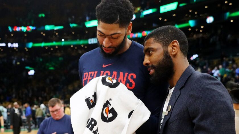 Anthony Davis and Kyrie Irving chat after a game in Boston in December. They could be teammates next season.