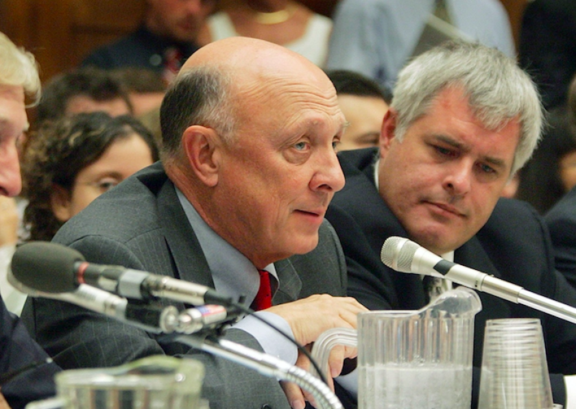 James Woolsey (left) testifies during a House Armed Services Committee hearing on national security on July 13, 2005. He was then a vice president with the corporation Booz Allen Hamilton. Woolsey will visit La Jolla on Oct. 27th to give a speech on cybersecurity.