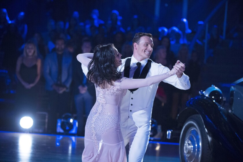 "Ryan Lochte performs with ""Dancing With the Stars"" partner Cheryl Burke on Sept. 12."