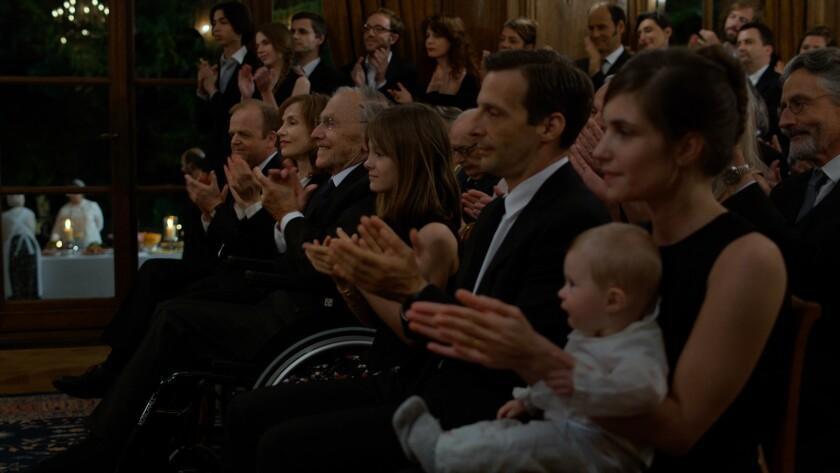 "Toby Jones, from left, Isabelle Huppert, Jean-Louis Trintignant, Fantine Harduin, Mathieu Kassovitz and Laura Verlinden in the film ""Happy End."""