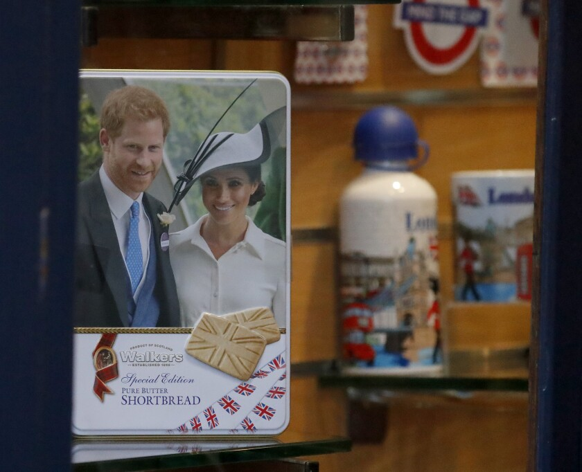 """Merchandising products are seen in a shop window in Windsor, England, Thursday, Jan. 9, 2020. In a statement Prince Harry and his wife, Meghan, said they are planning """"to step back"""" as senior members of the royal family and """"work to become financially independent.""""(AP Photo/Frank Augstein)"""