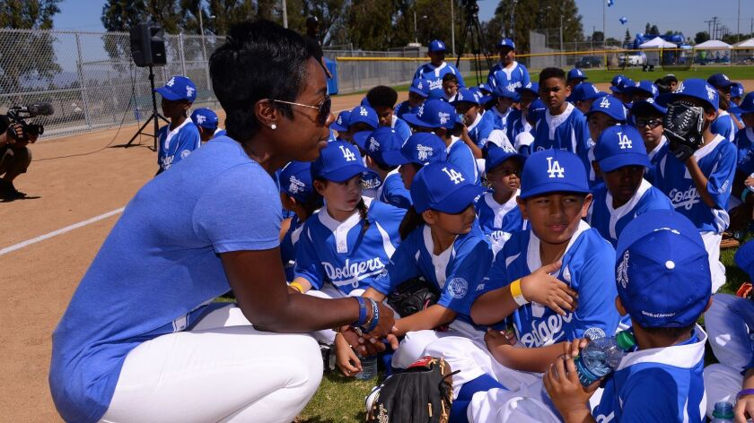 Nichol Whiteman, executive director of the Los Angeles Dodgers Foundation, talks to kids at Darby Park in Inglewood in May 2017.