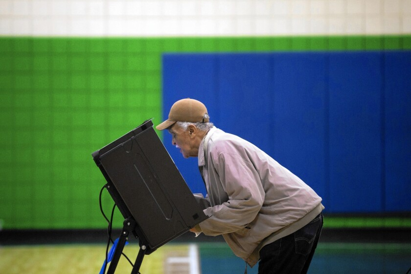 A voter in Greensboro, N.C., on Nov. 4. Early numbers indicate that voter turnout was up compared with 2010 in some parts of the fiercely fought battlegrounds of Alaska, Colorado, Iowa and North Carolina, according to one expert.