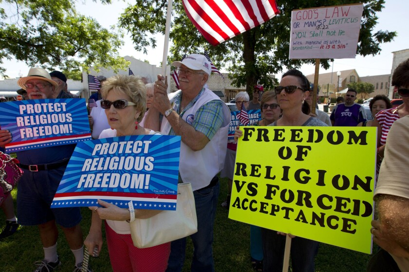 Supporters of Hood County Clerk Katie Lang gather at the courthouse in Granbury, Texas, on July 2, amid dueling same-sex marriage rallies.