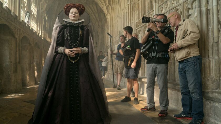 Actor Margot Robbie (left), Director of Photography John Mathieson (right) and crew members on the s