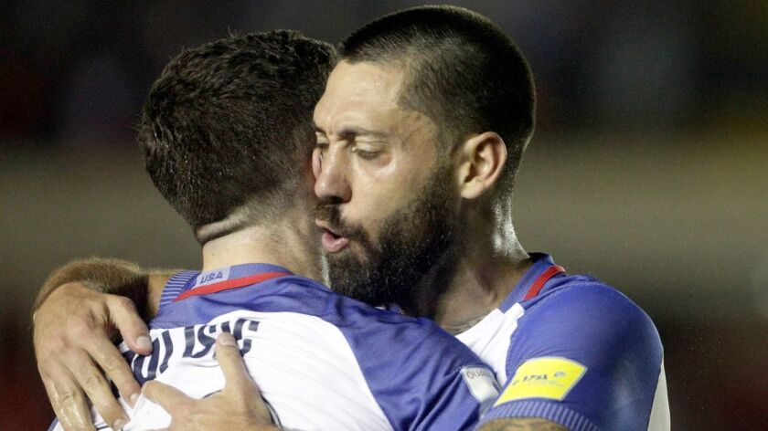 United States' Christian Pulisic, left, celebrates with teammate Clint Dempsey after Dempsey scored to give the U.S. a 1-0 lead over Panama during a World Cup qualifying soccer match in Panama City, Panama, on Tuesday