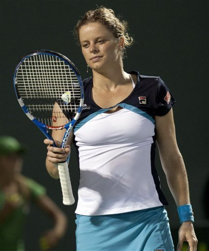 Kim Clijsters, of Belgium, looks reacts after she lost a game to Victoria Azarenka, from Belarus, at the Sony Ericsson Open tennis tournament in Key Biscayne, Fla., Wednesday, March 30, 2011. Azarenka won 6-3 and 6-3. (AP Photo/J Pat Carter)