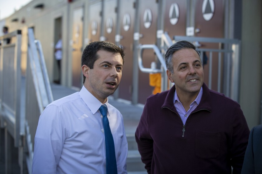 Councilor Joe Buscaino, right, is visiting Watts along with then-Democratic presidential candidate Pete Buttigieg in 2020.