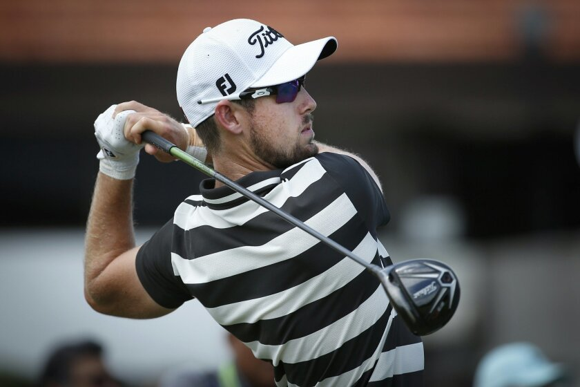 Nathan Holman of Australia watches his shot during day two of the Maybank Championship golf tournament in Kuala Lumpur, Malaysia, Friday, Feb. 19, 2016. (AP Photo/Vincent Thian)