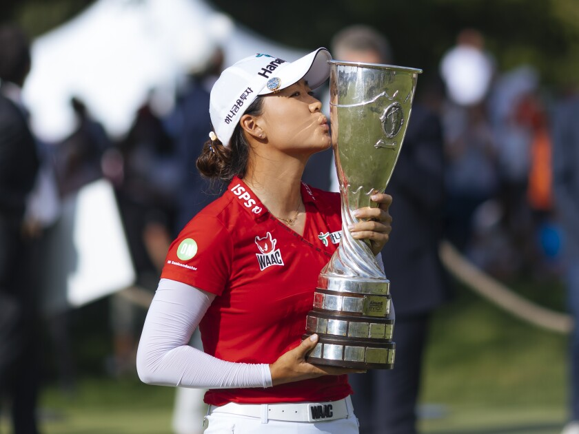 Australia's Minjee Lee kisses the trophy as she poses for photographers after winning the Evian Championship women's golf tournament in Evian, eastern France, Sunday, July 25, 2021. (AP Photo)