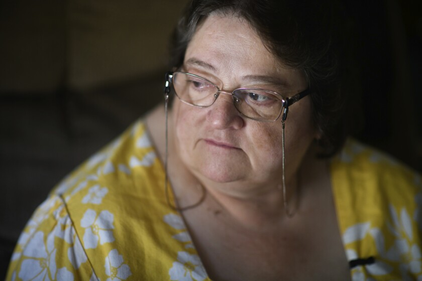 "Doris Kelly, 57, sits in her home on Monday, June 29, 2020 in Ruffs Dale, Pa. Kelly was one of the first patients in a University of Pittsburgh Medical Center trial for COVID-19. ""It felt like someone was sitting on my chest and I couldn't get any air,"" Kelley said of the disease. (AP Photo/Justin Merriman)"
