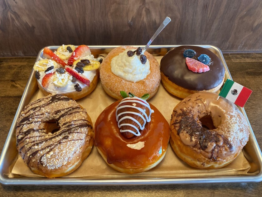 Family recipes and high-quality ingredients go into Barrio Donas' Mexican-flavored doughnuts. They are (from top left): bionico, arroz con leche and paleta payaso; (from bottom left) choco mazapan, flan and chocolate Abuelita.