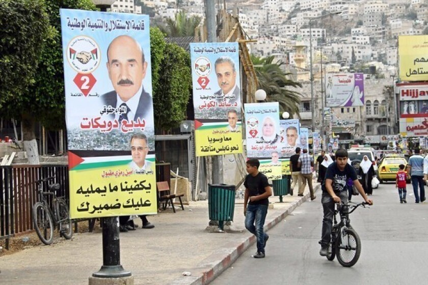 Campaign posters dot the West Bank city of Nablus for municipal elections scheduled for Oct. 20.