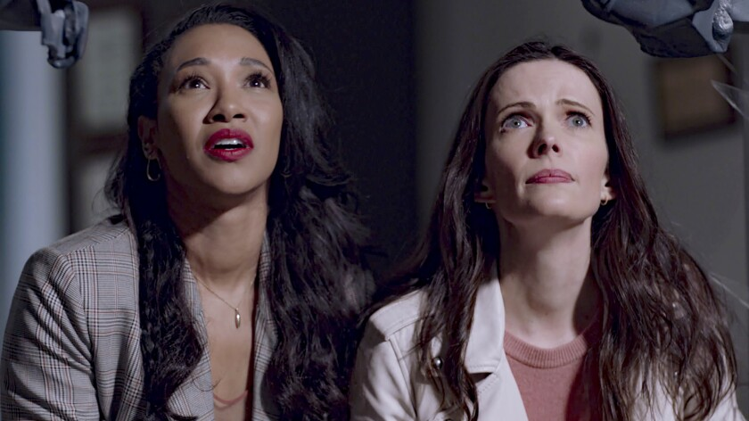"""Candice Patton, left, and Elizabeth Tulloch in """"Crisis on Infinite Earths: Part 2"""" on The CW."""