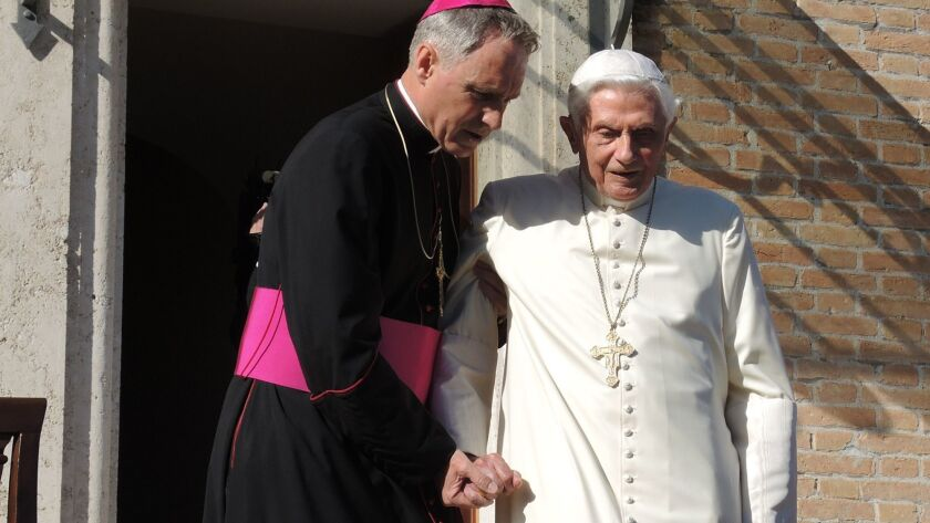 Retired Pope Benedict reemerges to step into the roiling clergy sex