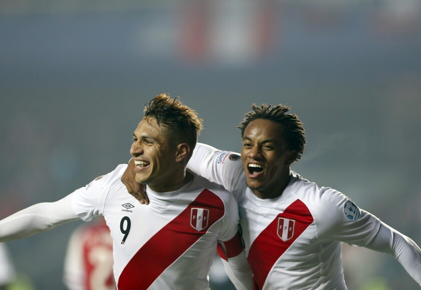Peru's Jose Paolo Guerrero, left, celebrates with teammate Andre Carrillo after scoring his team's second goal during the soccer match for the third place of the Copa America at the Ester Roa Rebolledo Stadium in Concepcion, Chile, Friday, July 3, 2015. Peru beat Paraguay 2-0 in a play-off match.(AP Photo/Andre Penner)