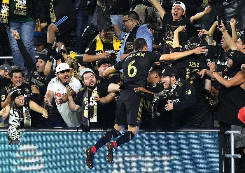 Danilo Silva celebrates at Banc of California Stadium with LAFC fans.