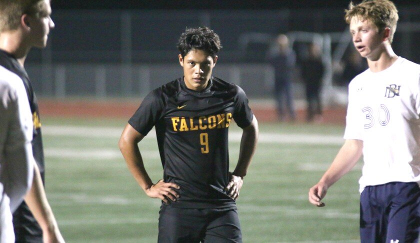 Senior Jose Salgado, who scored the Falcons' third goal, had his eyes on the prize.