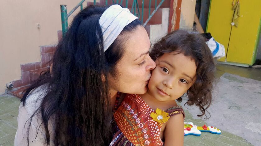 Kelly Galindo with a three-year-old trafficking survivor in Mexico. (Courtesy of Alberto De Coste Ca