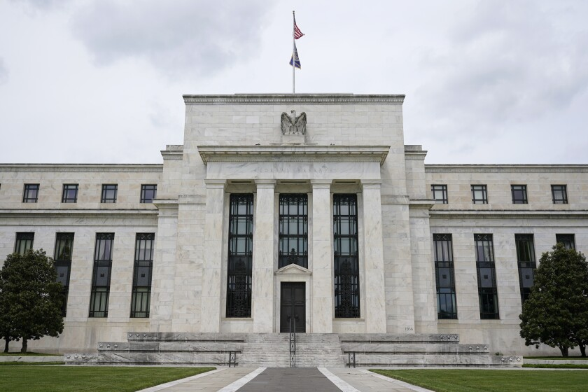 FILE - This May 4, 2021, file photo shows the Federal Reserve building in Washington. An independent investigator will look into whether Federal Reserve officials broke the law with financial trades in 2020 that have come under congressional scrutiny and sharp criticism from outside the Central Bank. (AP Photo/Patrick Semansky, File)