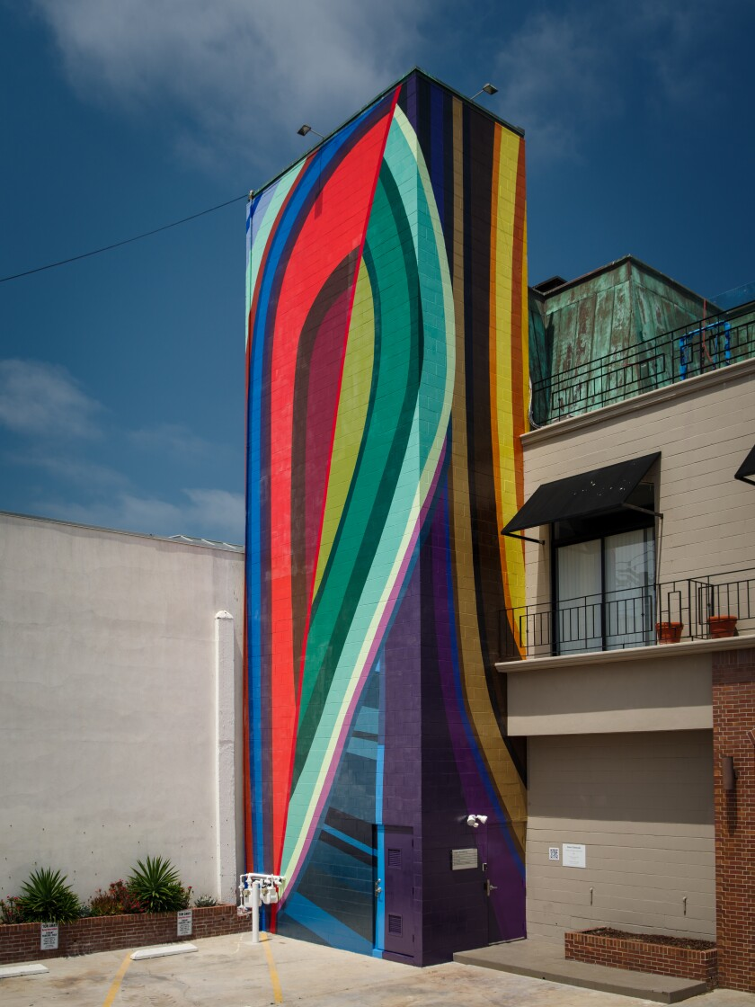 """June Edmonds' mural """"Ebony on Draper and Girard"""" is on the alley-facing side of 7724 Girard Ave. in La Jolla."""