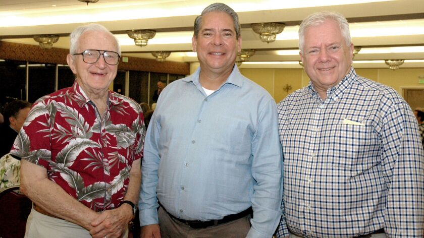 City Council member Bob Frutos, center, is flanked by father and son, Sam Engel Sr., left, and Sam E