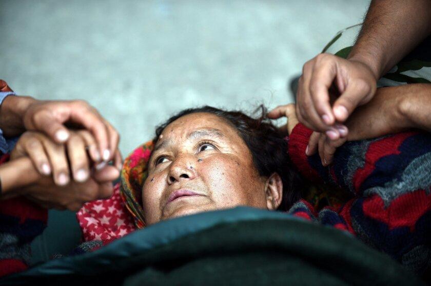 An injured Nepalese woman at a field hospital at a Katmandu airport April 29.