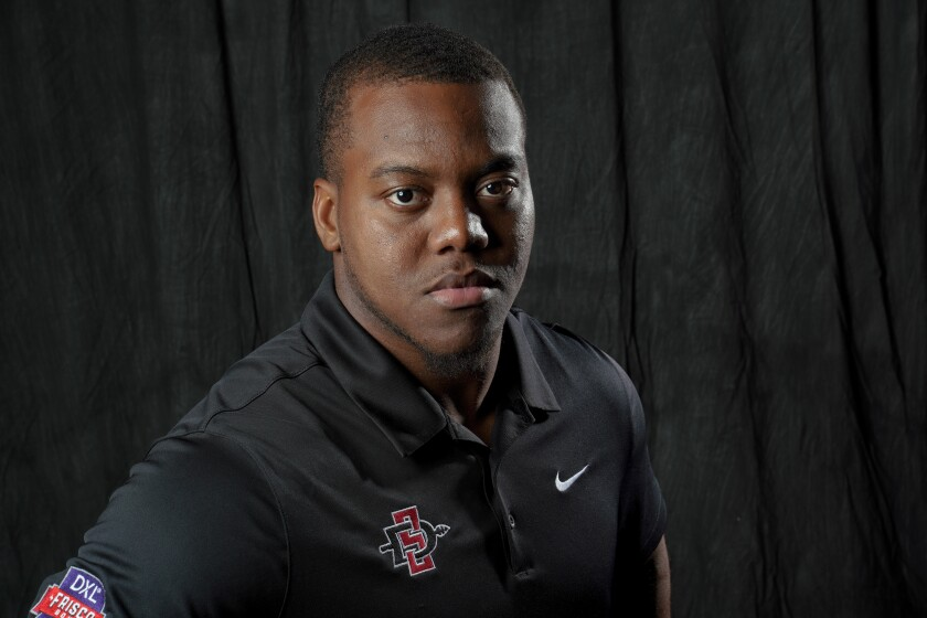 San Diego State linebacker Kyahva Tezino earned first-team all-conference honors for the second straight year.