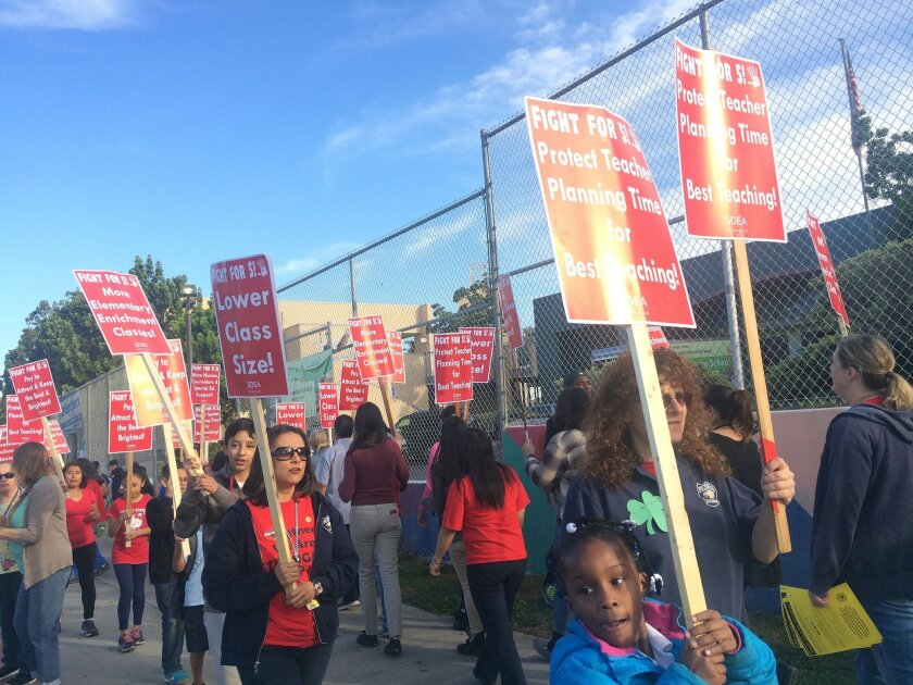 San Diego teachers and their supporters rallied in March at Perkins K-8 School in Barrio Logan after the teachers union declared an impasse in contract talks with the San Diego Unified School District. / photo by Maureen Magee * U-T San Diego