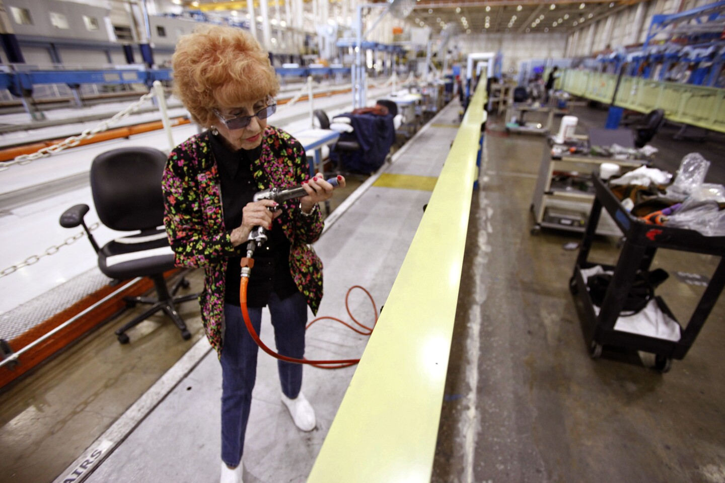 """Elinor Otto, 93, prepares to rivet a wing while working at Boeing in Long Beach. """"Don't get in her way, she'll run you over,"""" a co-worker says."""