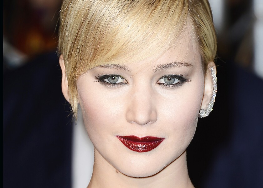 """Jennifer Lawrence with a diamond ear cuff at the Paris premiere of """"The Hunger Games: Catching Fire"""" in 2013."""