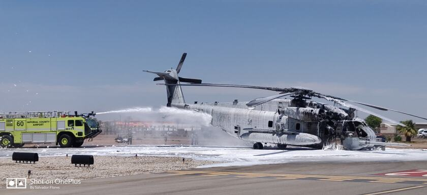 Imperial County Fire Department battles a fire on a Marine Corps CH-53E Super Stallion helicopter at the Imperial County Airport Thursday. No Marines were injured in the blaze.