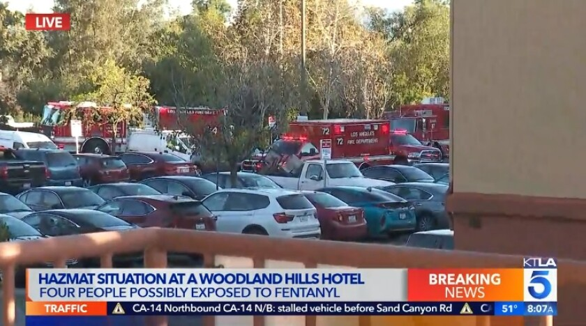 Los Angeles fire officials responded to a hotel Tuesday morning in Woodland Hills after four people were possibly exposed to fentanyl.