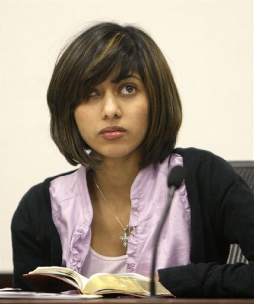 Rifqa Bary listens to the judge during a hearing to settle disputes between her and her parents Tuesday, March 2, 2010, in Columbus, Ohio. (AP Photo/Jay LaPrete)